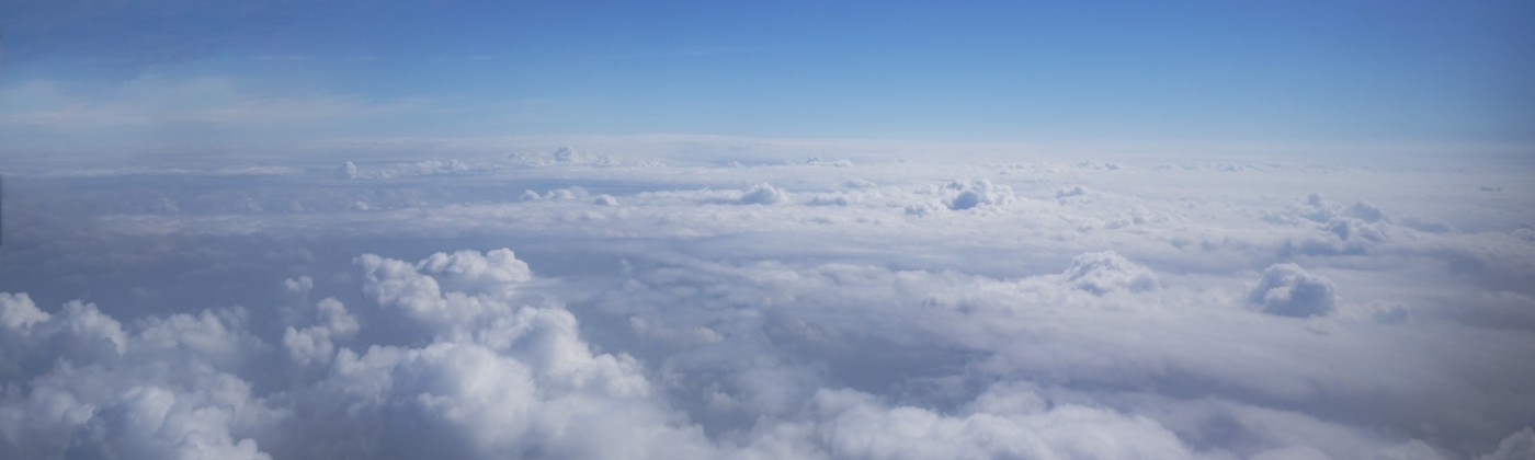 Cloudscape and stratosphere shot out of an airplane window.