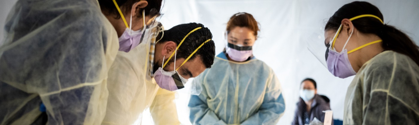 Doctors test hospital staff with flu-like symptoms for coronavirus (COVID-19) in set-up tents to triage possible COVID-19.