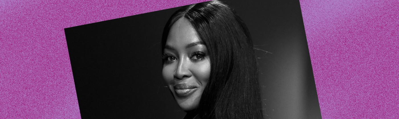 Black and white photo of Naomi Campbell against a violet background.