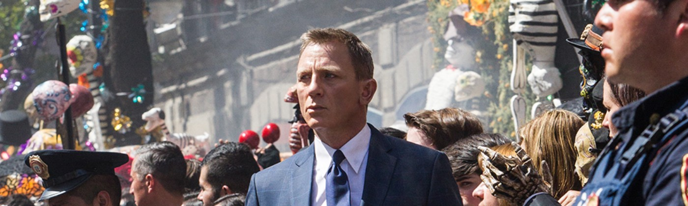 Daniel Craig as James Bond walks through a crowd from the movie set of 007: Spectre.