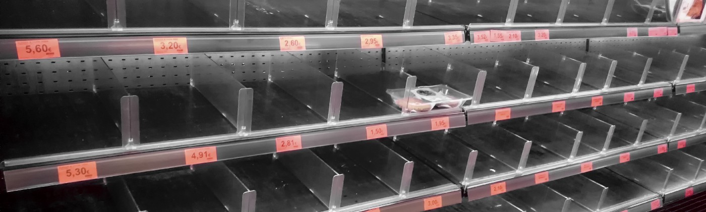 Empty meat shelves at the grocery store.