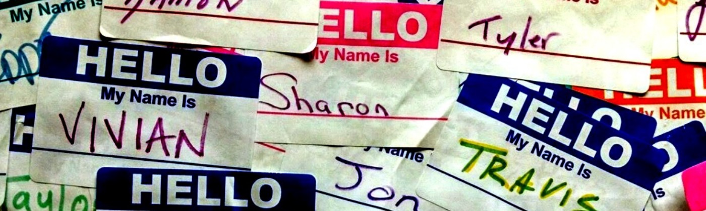 "A collage of ""Hello My Name Is"" stickers with names such as: Damon, Sharon, Tom, Jon, Vivian, Travis, and Kristal."