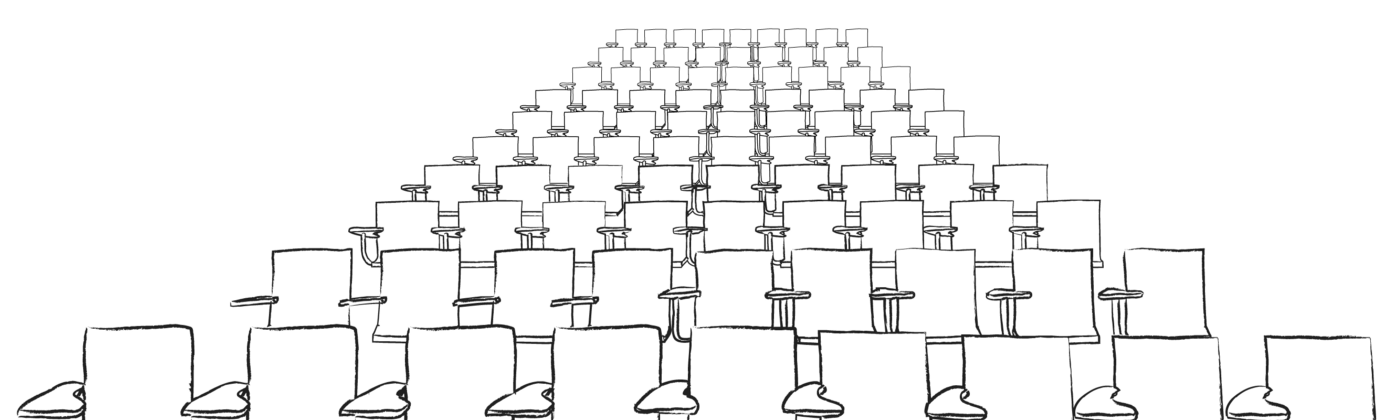Rows of empty lecture hall chairs in auditorium-style seating.