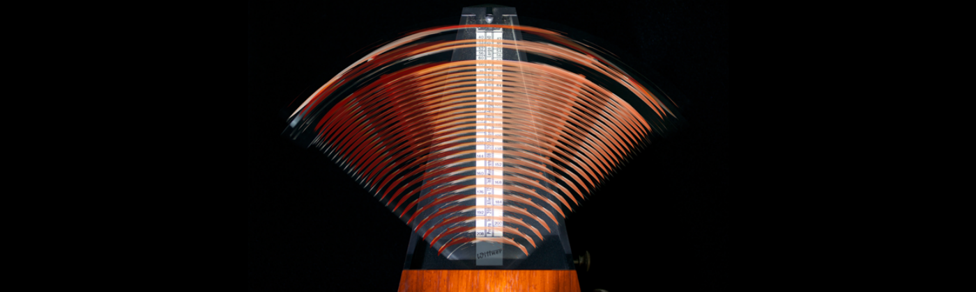 A time lapse photo of a metronome in motion.
