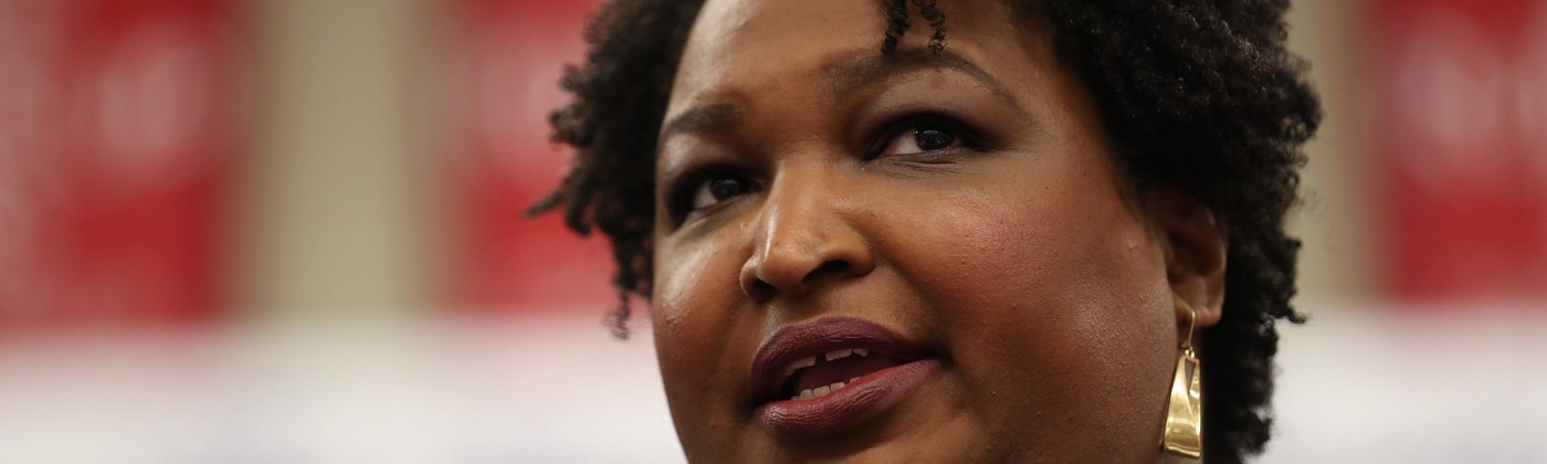 A closeup photo of Stacey Abrams speaking at an event.