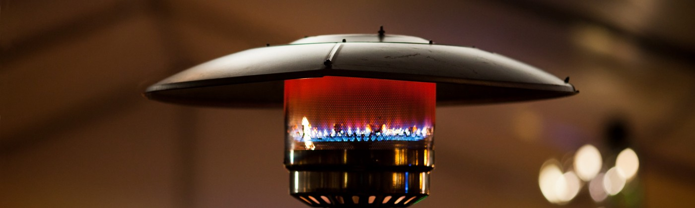 Outdoor gas heater at night.