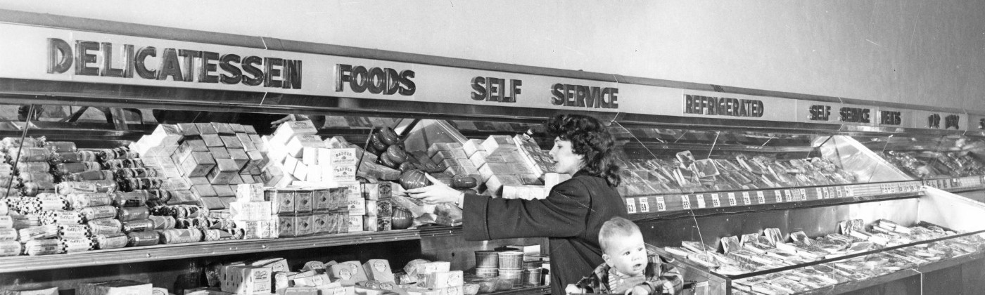 People picking up treats at a self-serve delicatessen in Bergs Supermarket, circa 1950.