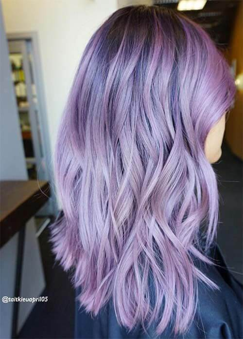 Pastel hair is never a bad idea. This stylist has incorporated both dark and light highlights in this lilac look.