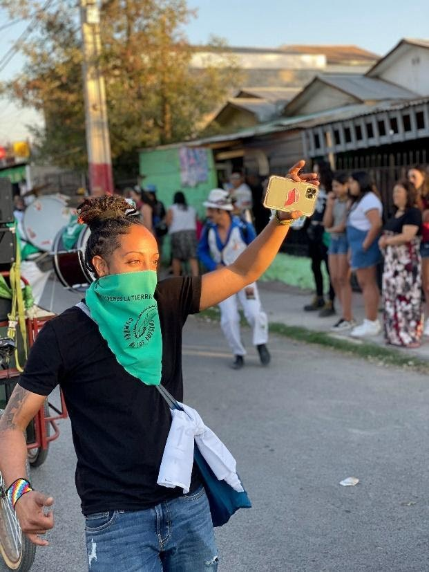 Photo of activist Christian Rodriguez from the Ironbound Community Corporation wearing a green bandana