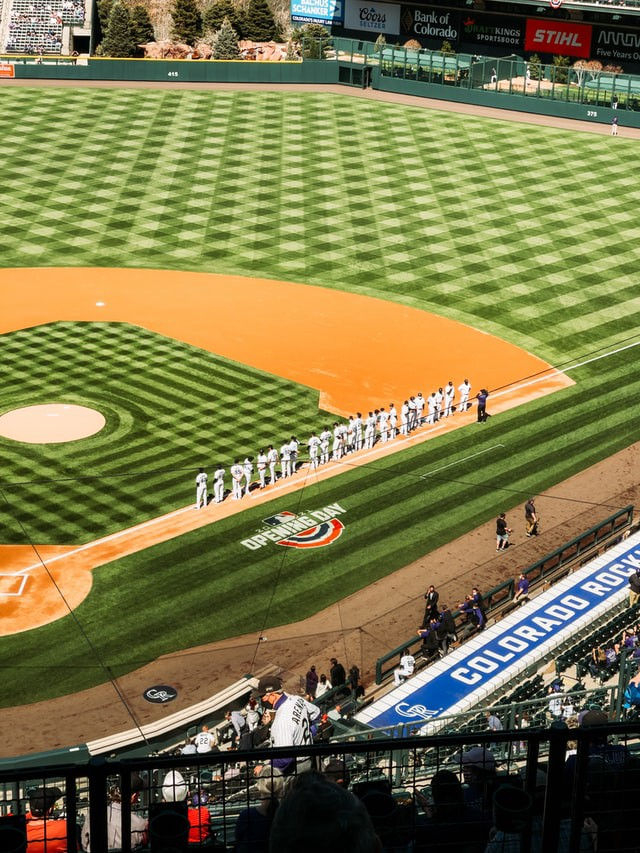 Baseball players lined up during the national anthem performance