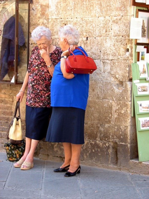 Two old ladies gossiping