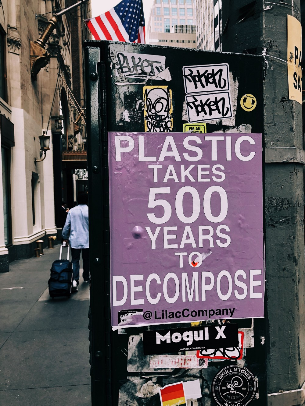 """A lilac colored poster that reads """"plastic takes 500 years to decompose"""""""