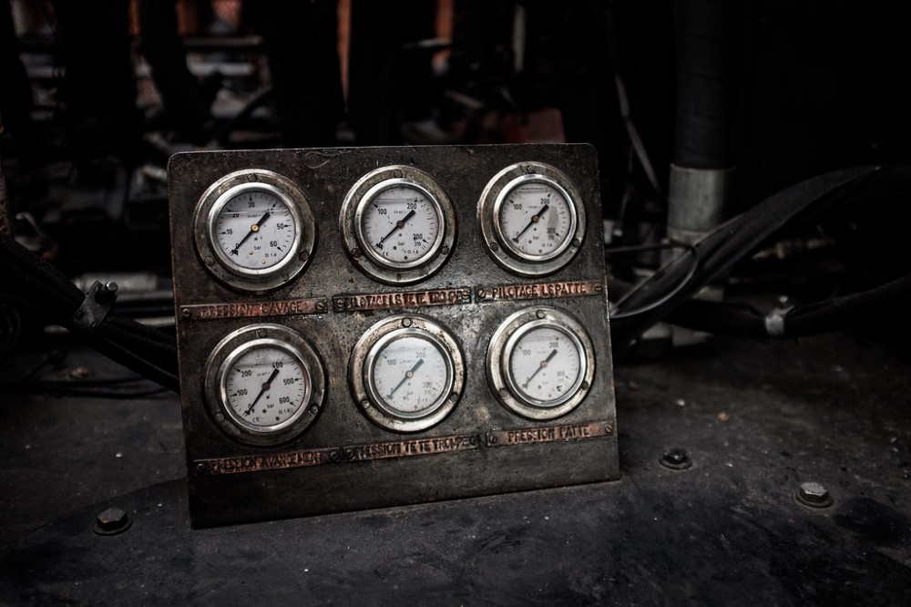 """An image of pressure gages entitled """"Under Pressure"""" which aligns to the title and article."""