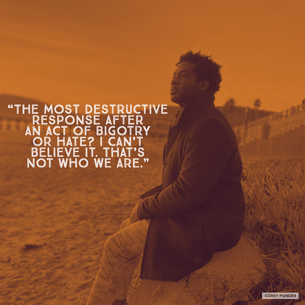 a man sitting on the beach, with the quote about disbelief in bigotry and hate being as destructive as the act itself