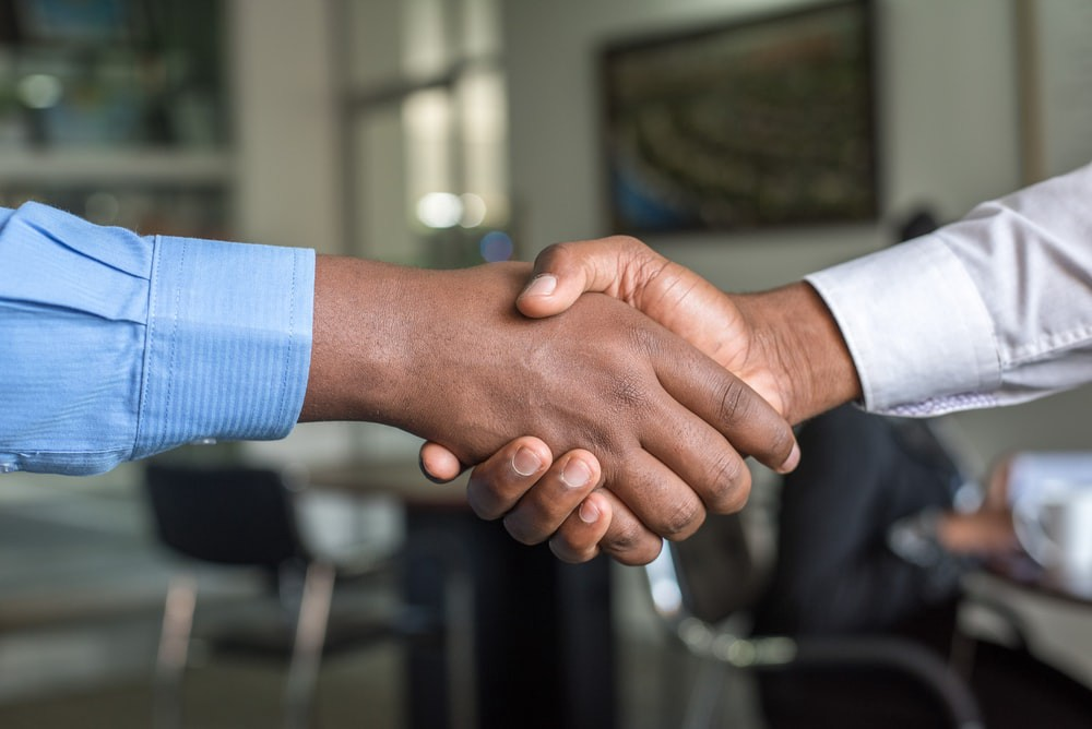 two people shaking hands after hiring.