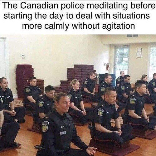Canadian police meditating before duty