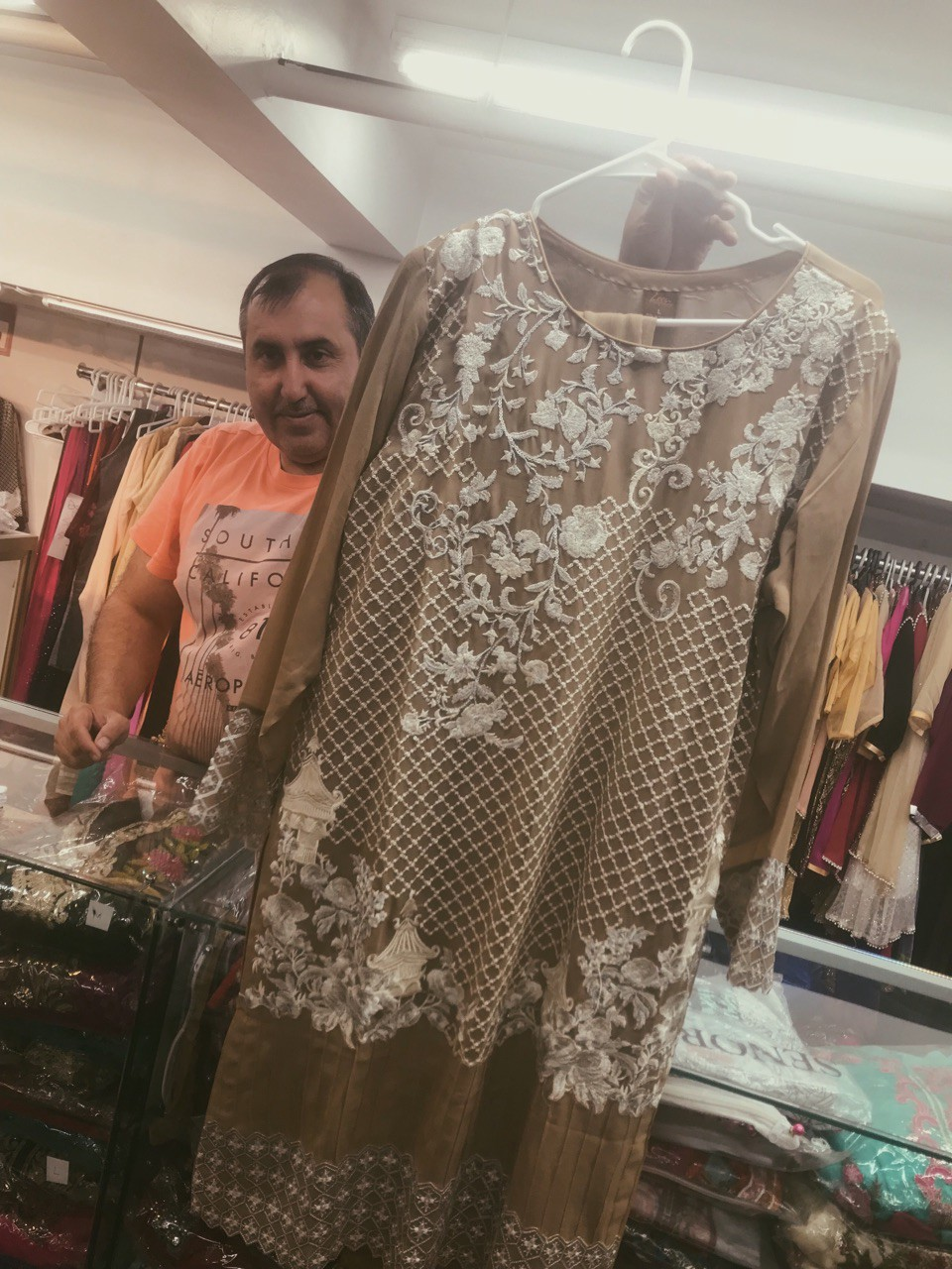 7849aae08c13 Mr. Khan holds a traditional shalwar kamees imported from Pakistan/Sabrina  Ticer-Wurr