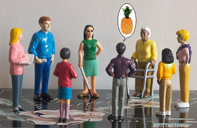 A set of toy figurines seem to talk in a circle; a pineapple appear above one of them, please read the post for context!