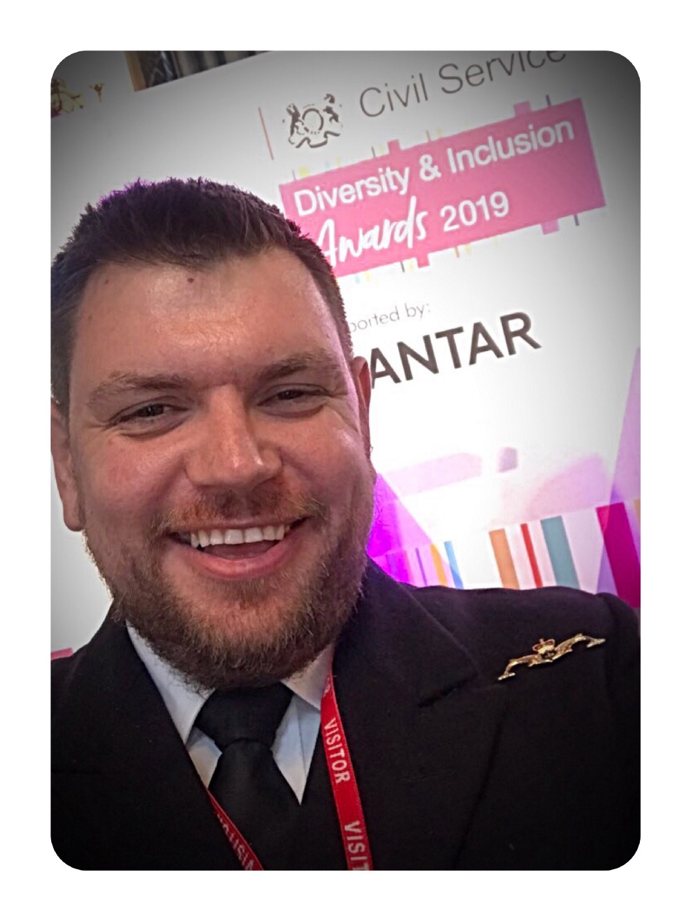 A selfie of a man in a Navy uniform, smiling at the 2019 Diversity and Inclusion awards