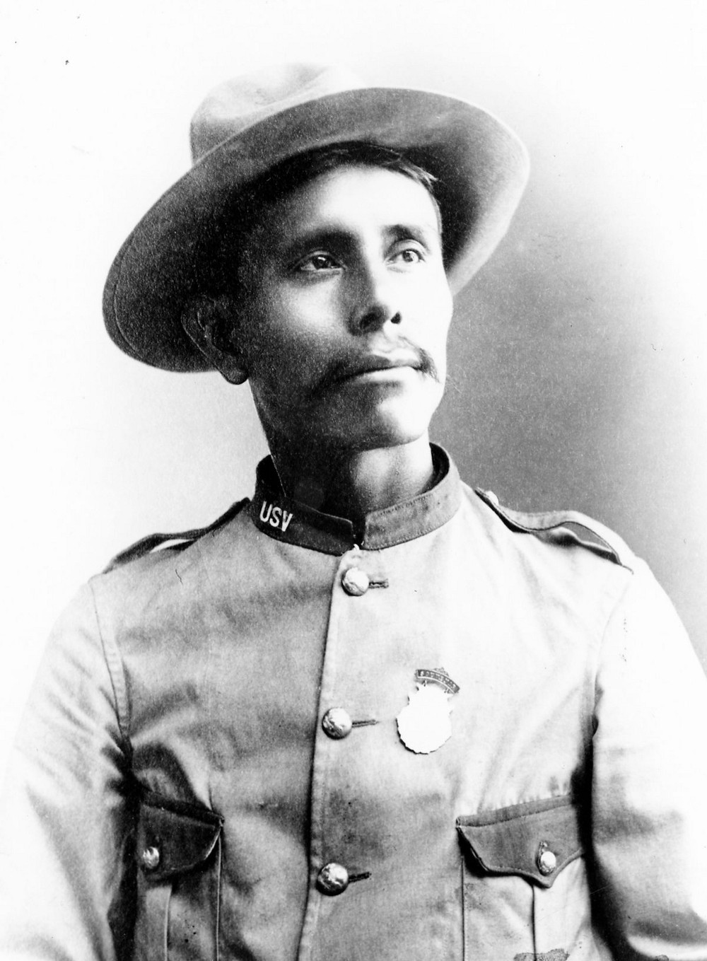 A portrait of William Pollack in a Rough Rider army uniform