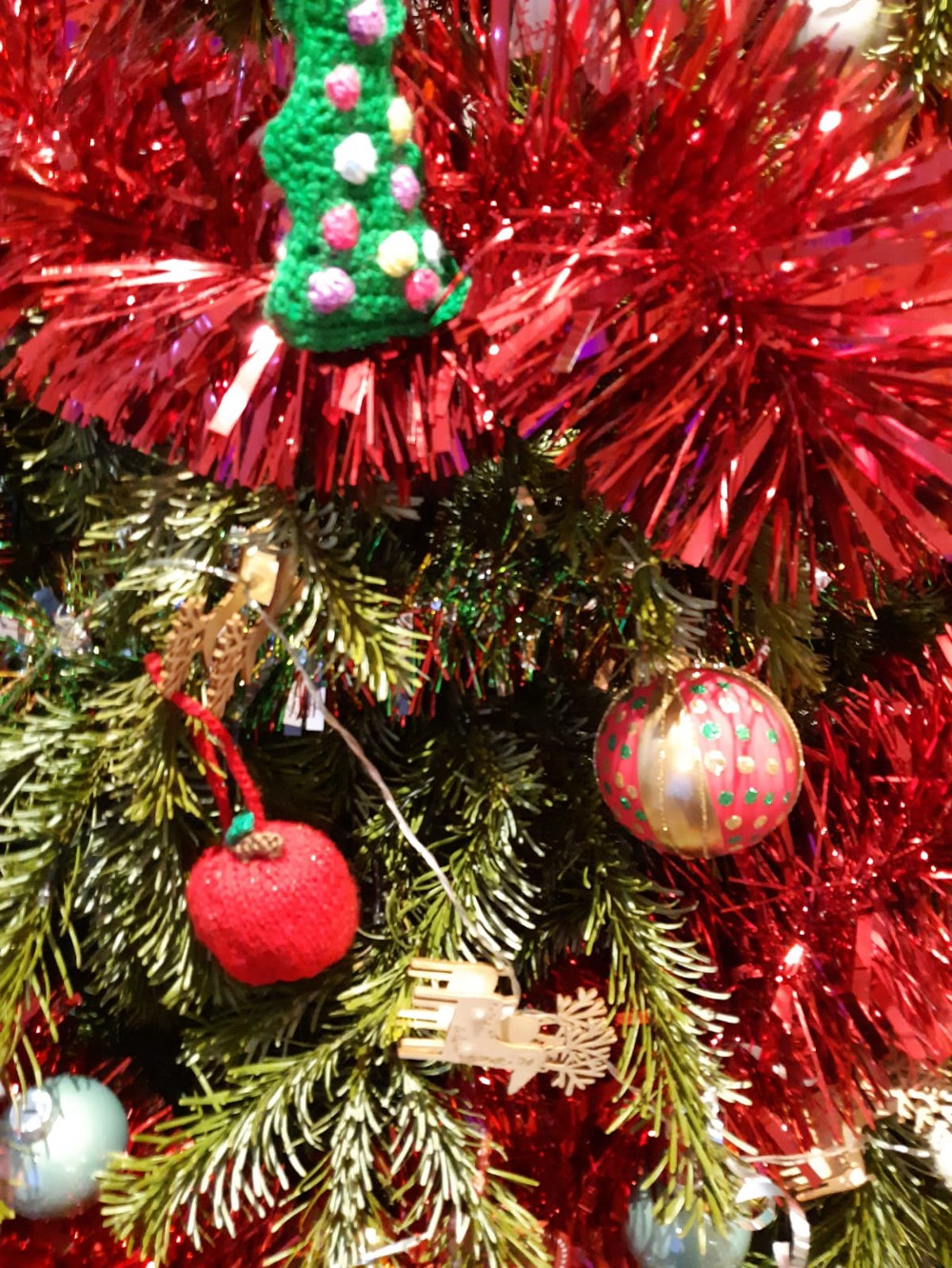 A close up of tinsel on a Christmas tree