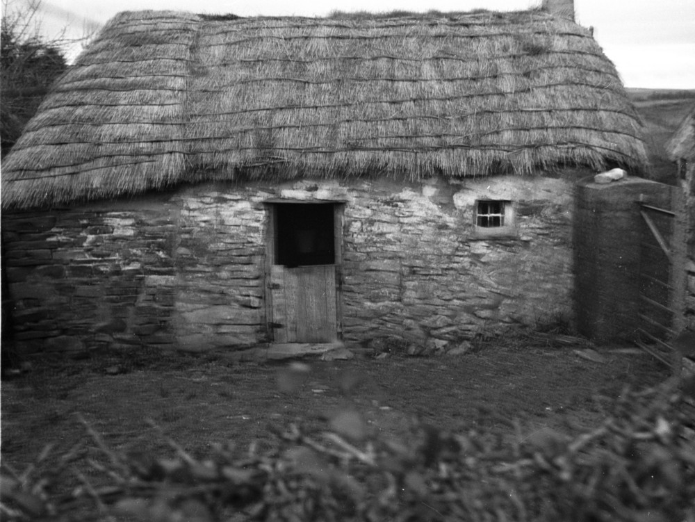 A black-and-white photograph of a thatched hut near Athea, Co. Limerick, taken in 1940.