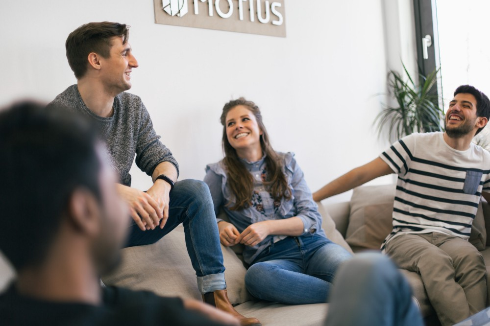 Motius chat in office