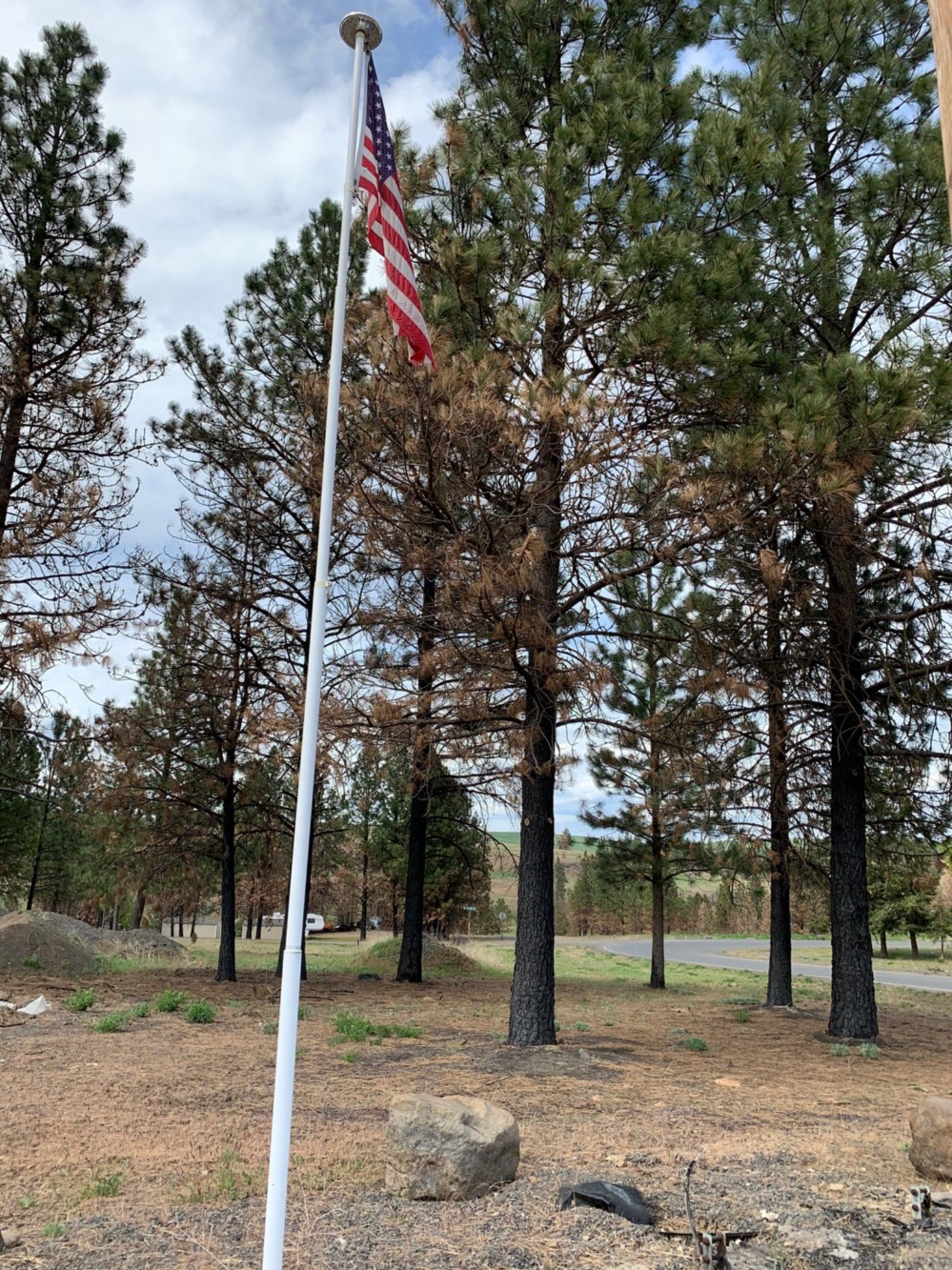 New flagpole installed on the site of what will be the town's new post office.