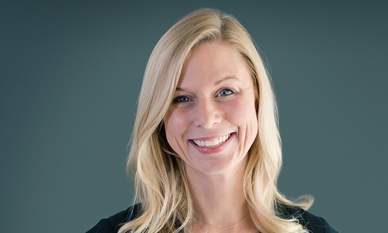 Color photo of Crystal Sumner, a blonde, blue eyed woman who is smiling, the author of this article and Head of Legal for Blend.