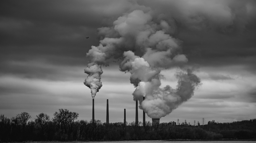 Black and white picture of billowing smoke from petrochemical plants.