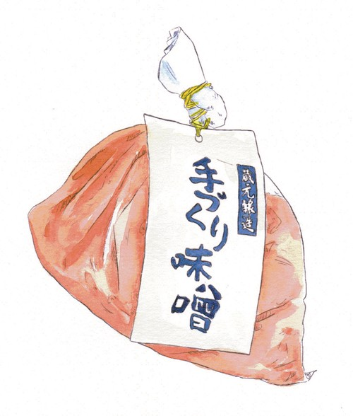 A plastic bag with indistinct, reddish food. A label written in Japanese is attached to it.