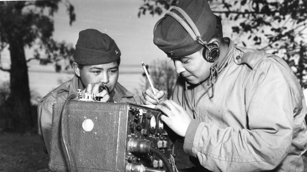 Two soldiers operate radio equipment