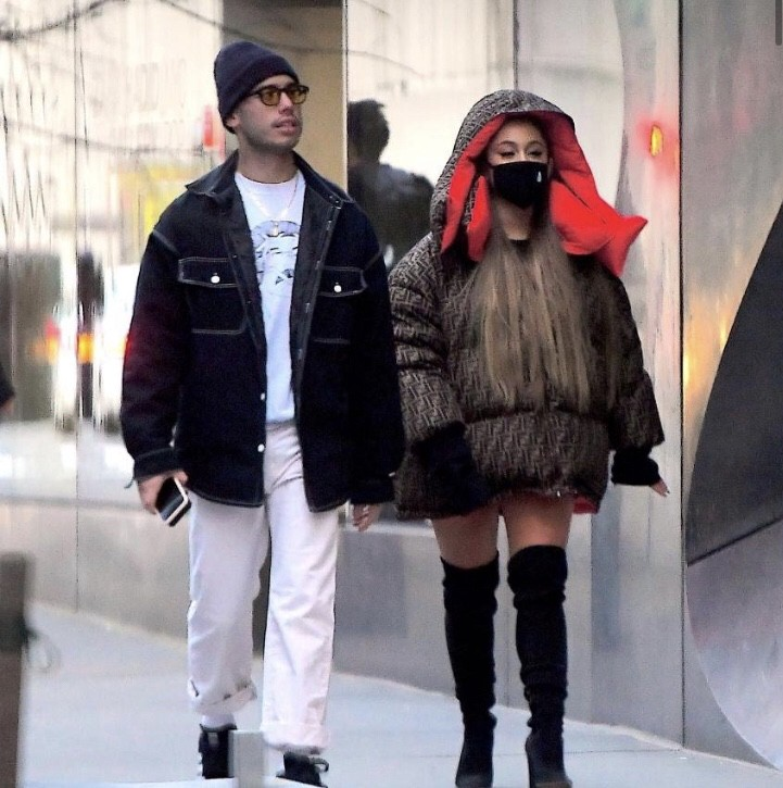 Ariana Grande and friend walking in the city, she is wearing a black cloth mask