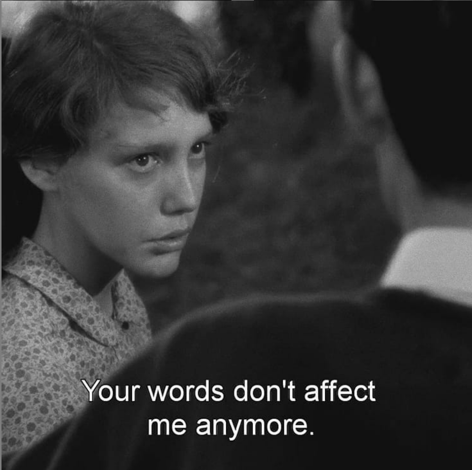 Black and white photo of a young girl is teary and speaking to a man who's face we can't see. The subtitle says: Your words don't affect me anymore. The image is a screenshot from Robert Bresson's film: Au Hasard Balthazar.