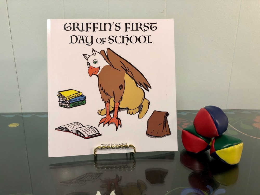 griffin's first day of school next to juggling balls