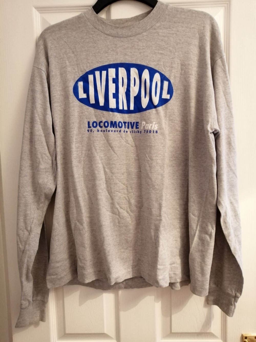 Liverpool in Paris long sleeved T shirt in grey with blue logo saying Liverpool on the front.