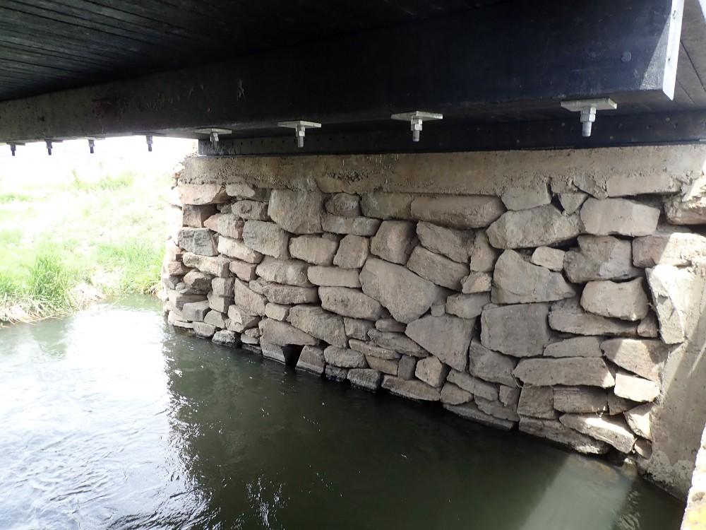 The new bridge span rests on rock abutments that were built by the Civilian Conservation Corps in the 1930s.