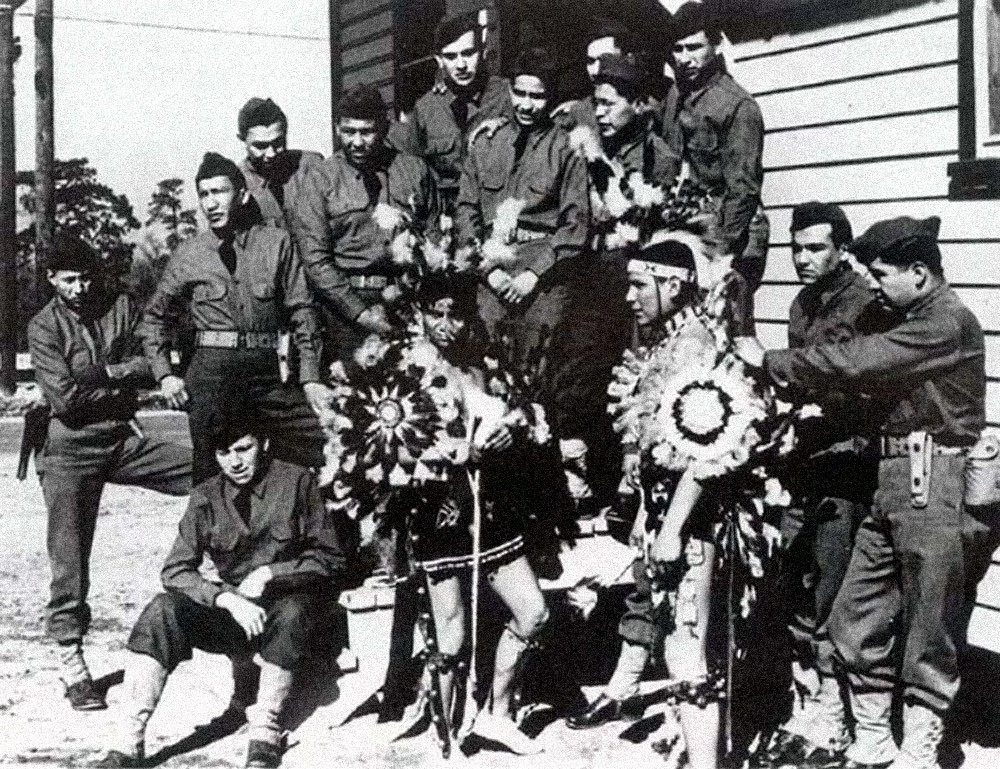 A group of soldiers, several wearing traditional Native American clothing