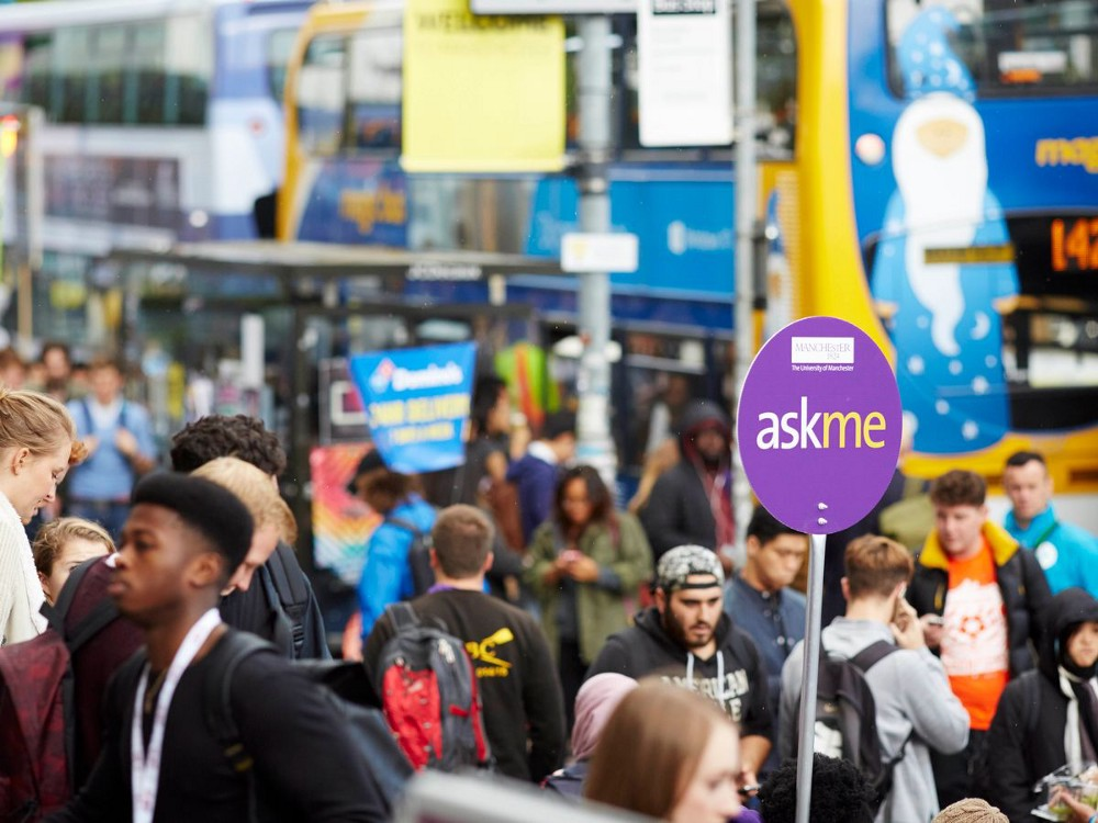 Busy oxford road during welcome week, crowds, magic buses, ask me signs