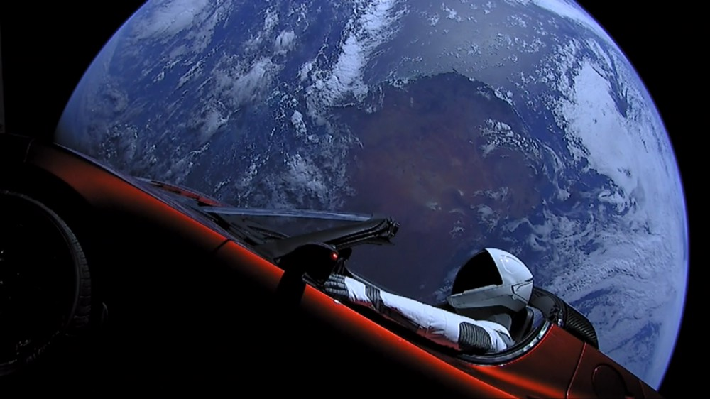 """Debut Falcon Heavy launch, 6 Feb 2018. """"Tesla goes to space"""". Image courtesy of Spacex.com"""