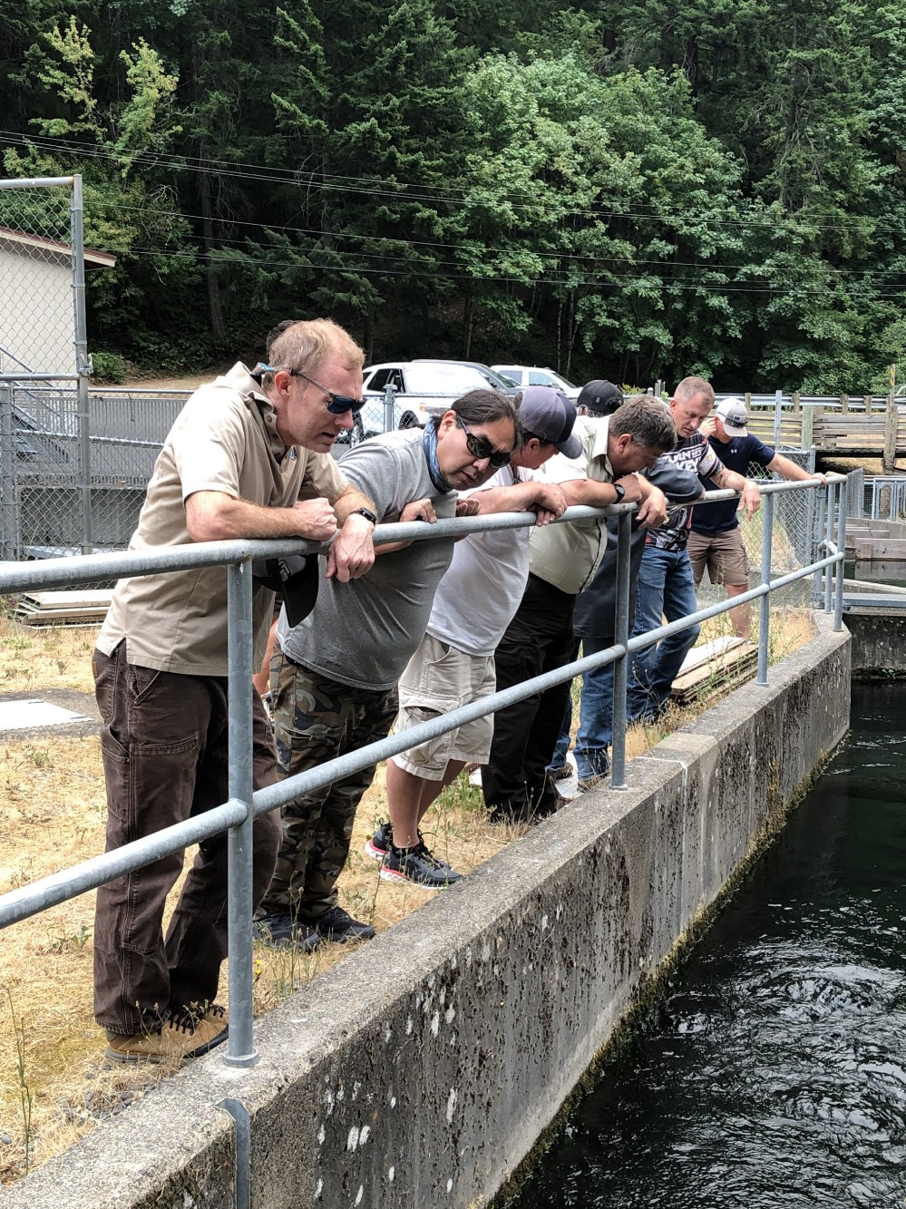Members of Yakama Nation and U.S. Fish and Wildlife Service staff evaluate the fish ladder at Little White Salmon NFH. Photo by Cheri Anderson / USFWS