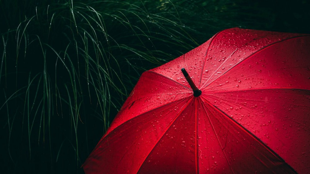 Red umbrella with droplets of rain.