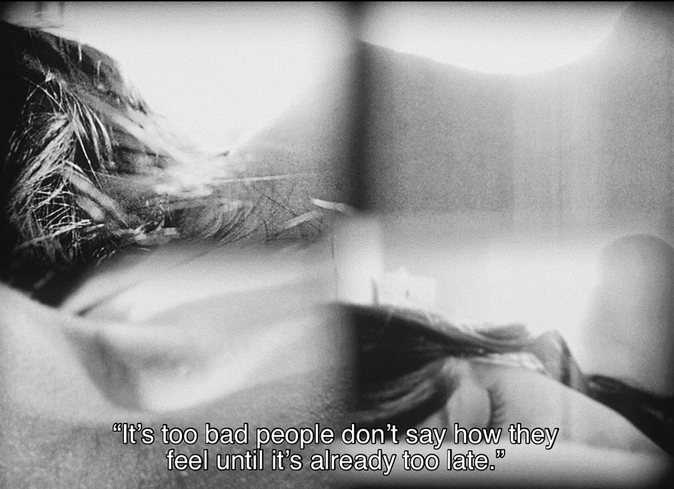 """Screen shot from: It's Such a Beautiful Day (2012) by Don Hertzfeldt. A kalidescope view of a woman laying on a pillow with her eyes closed. Subtitle says: It's too bad people don't day how they feel until it's already too late."""""""