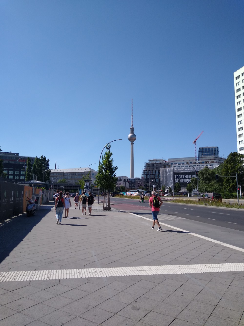 A snapshot of the road leading to Alexanderplatz (Berlin) with the famous TV Tower standing tall in the background.