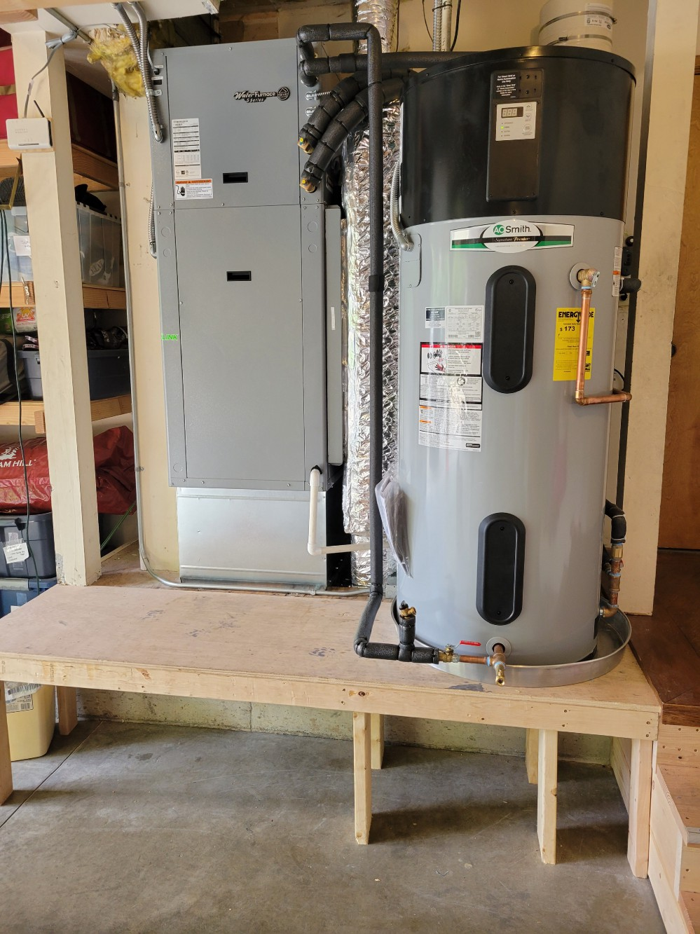 The new heat pump and hybrid heat pump hot water heater, installed and running.