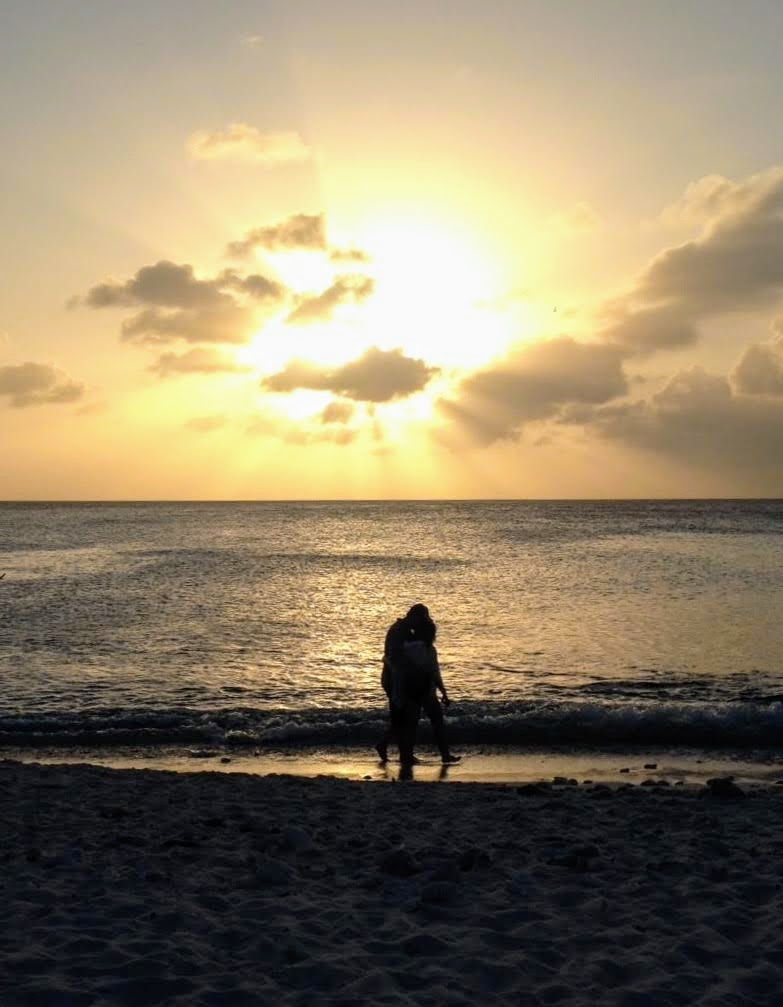My love and I walking on the beach during sunset in Curacao 2018