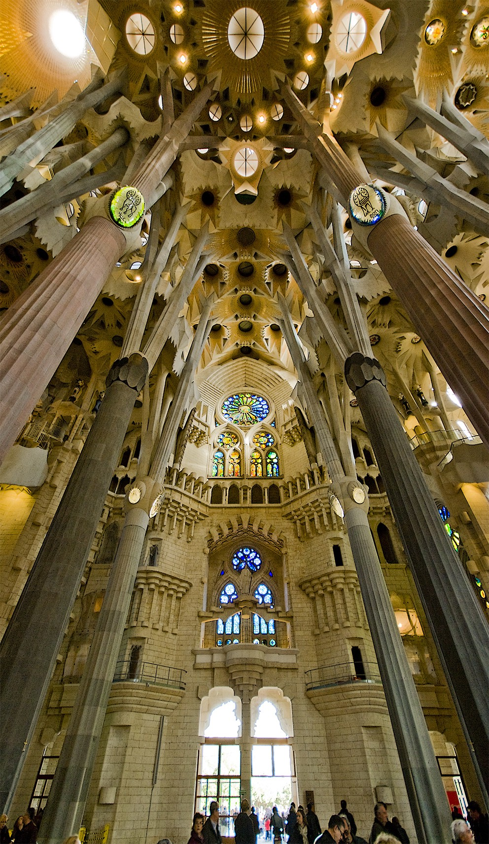 The inside of the Sagrada Família, complete with impressive stone structures and stained glass.