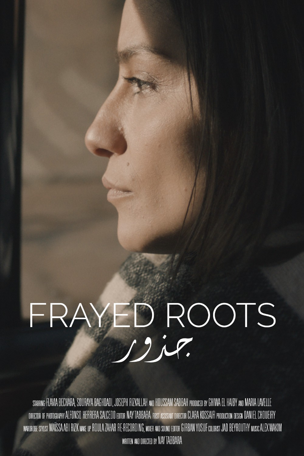 """The profile of a woman with """"Frayed Roots"""" overlaying the image."""