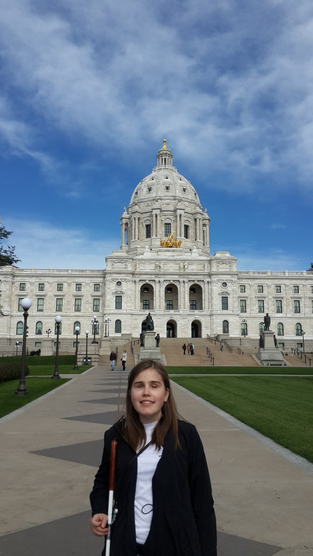 Anna standing infront of what looks like a historical government structure