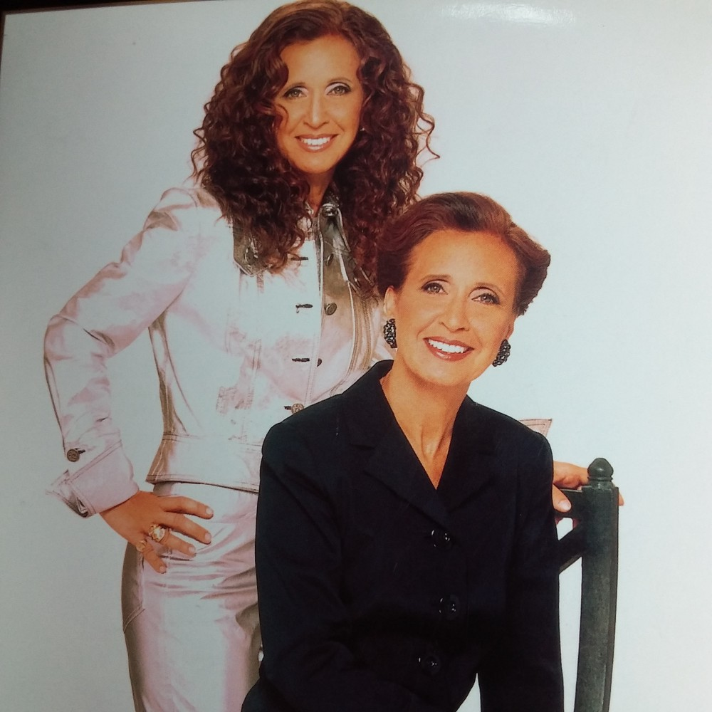 An image of Danielle Steel sitting and dressed conservatively, while behind her stands another, funkier Danielle Steel.